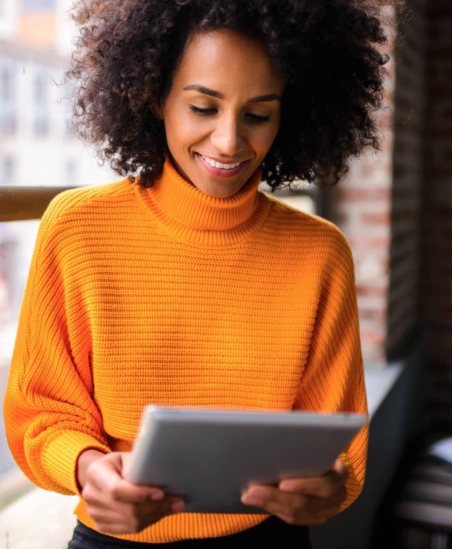Woman in Mustard Sweater on iPad