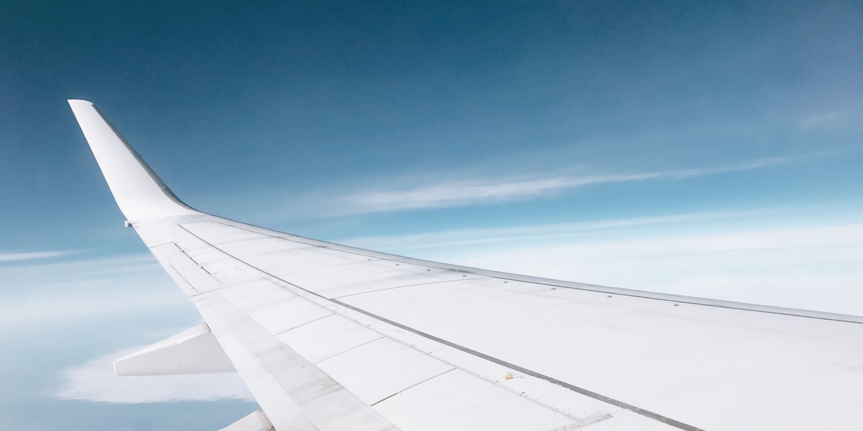 travel-loans-airplane-wing