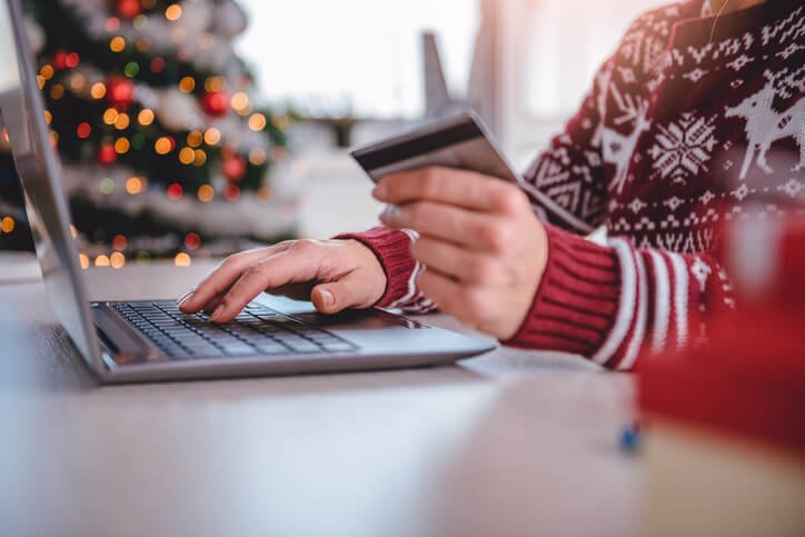 A person starting holiday shopping from home laptop