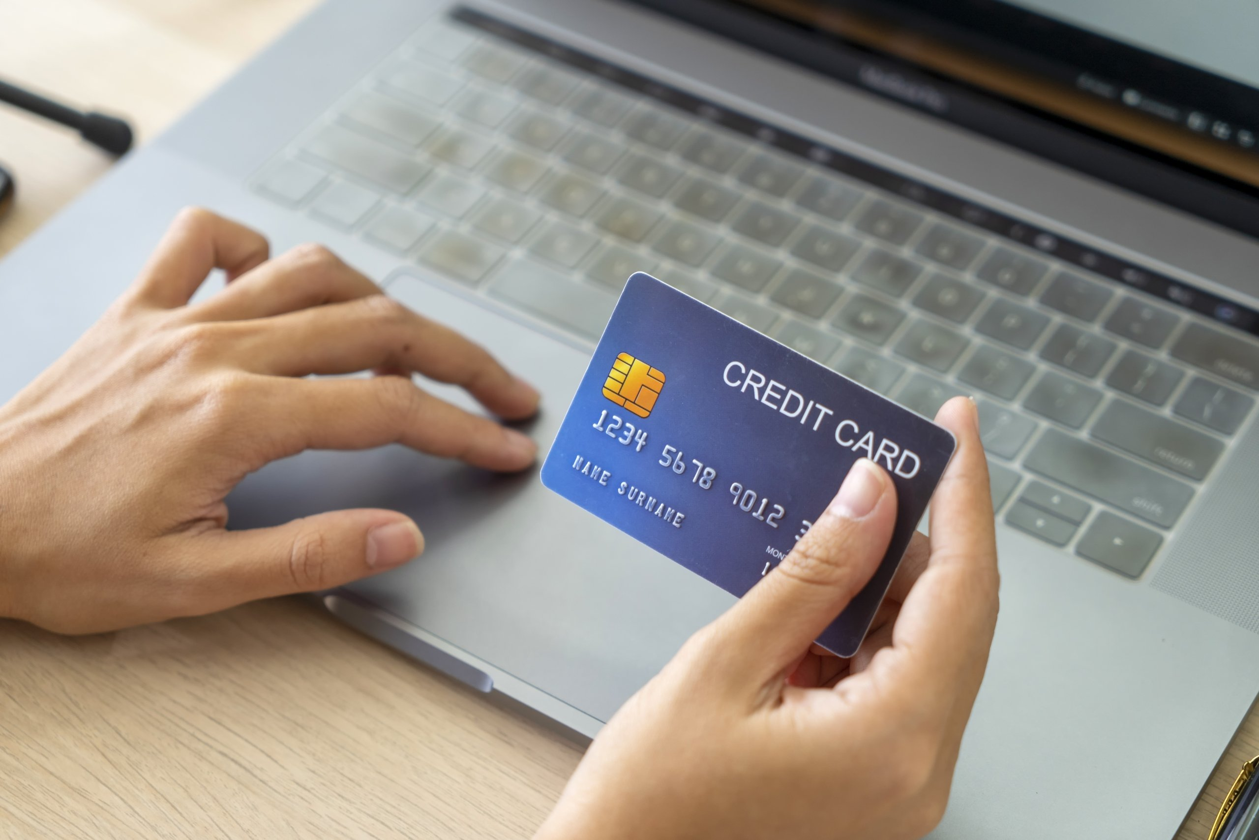 A person checking the online balance on a credit card