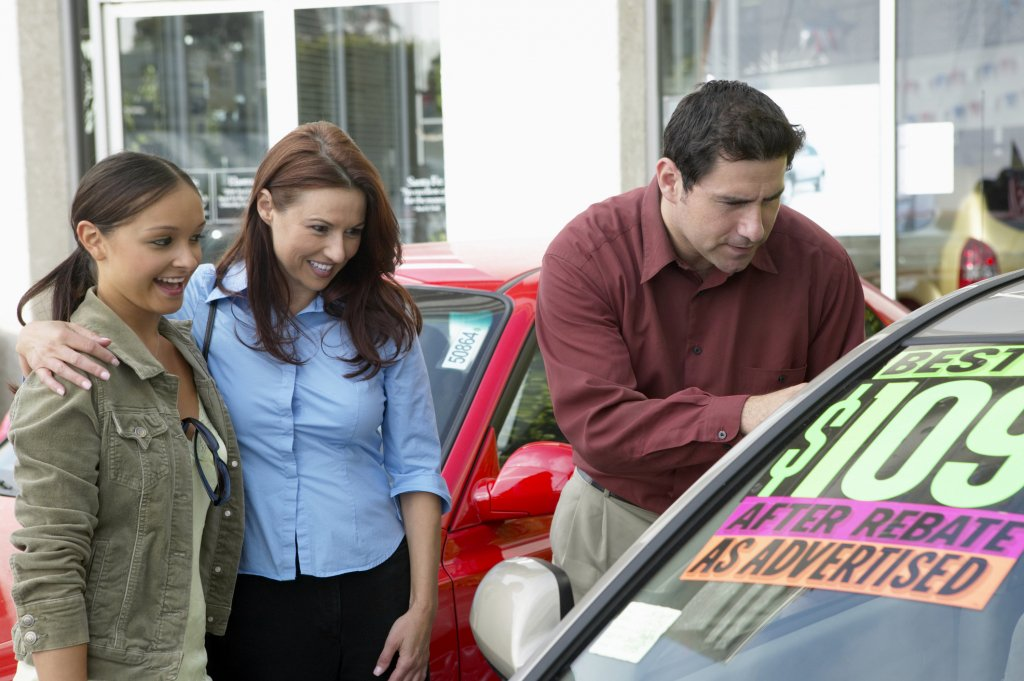 Girls smiling while purchasing a used car on sale